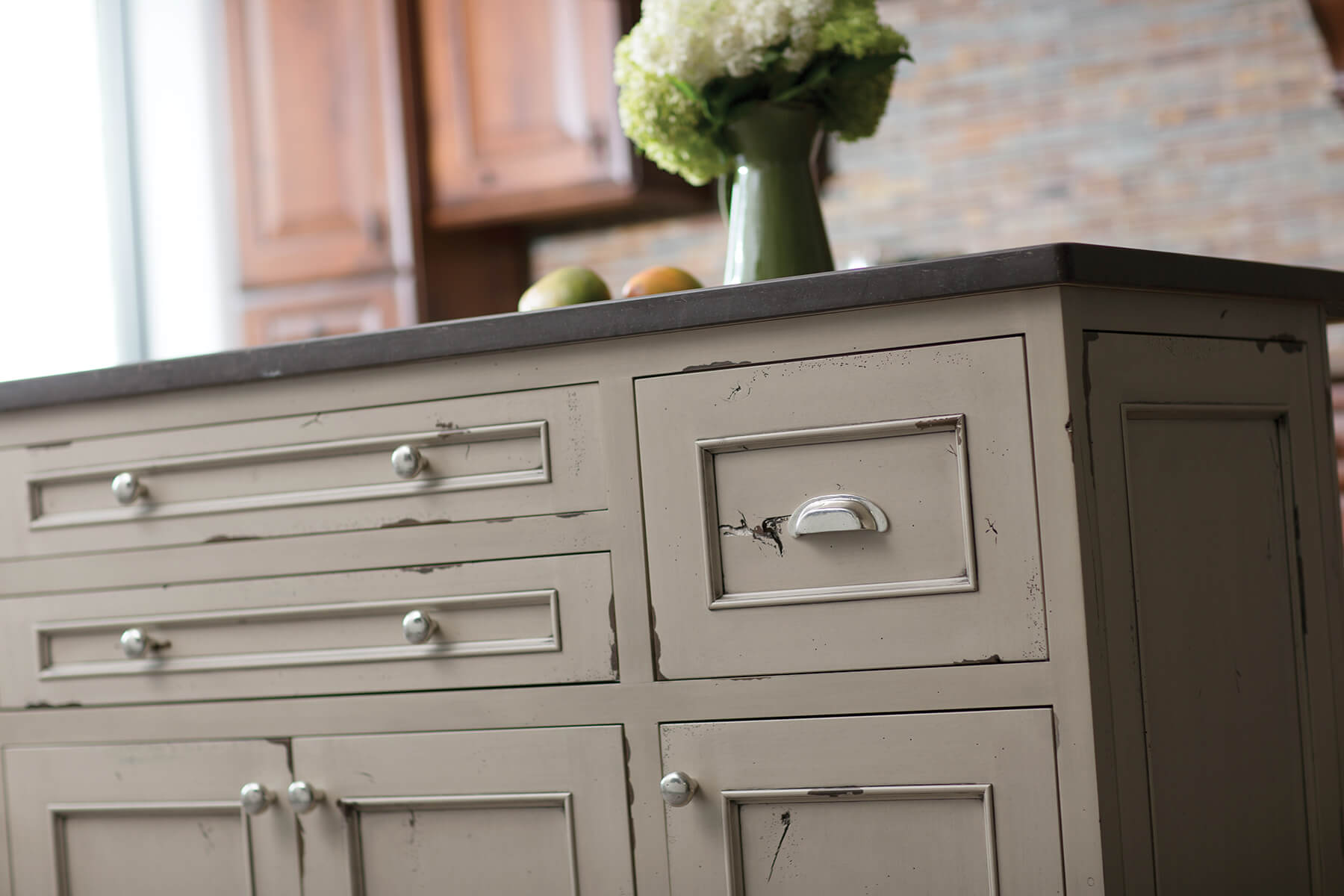 A kitchen island with a beautiful distressed paint finish with Dura Supreme's Heritage Paint finish.